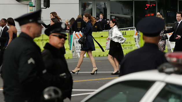 Extra police officers patrol outside the entrance to the 55th annual Grammy Awards. (AP Photo/Chris Carlson)