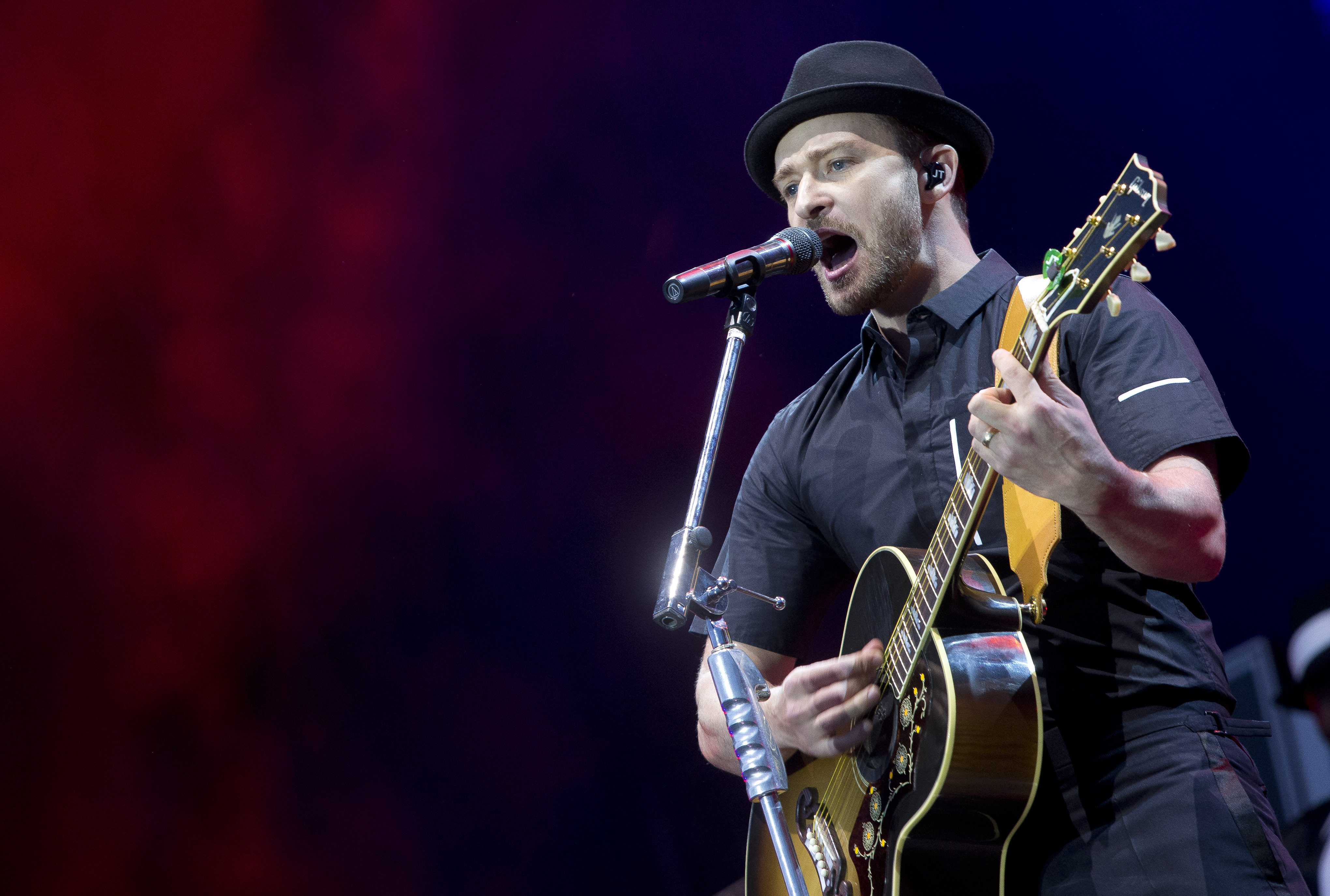 Justin Timberlake performs on stage during the Wireless Festival at the Queen Elizabeth Olympic Park, in East London, Friday, July 12, 2013. This year the festival moves from its usual home of Hyde Park to take place at London's Olympic Stadium. (Photo by Joel Ryan/Invision/AP)