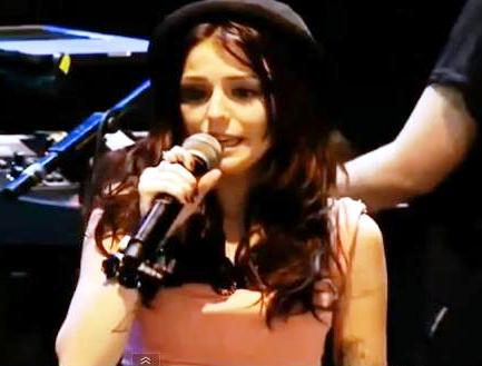 A distraught Cher Lloyd performs at the V Festival
