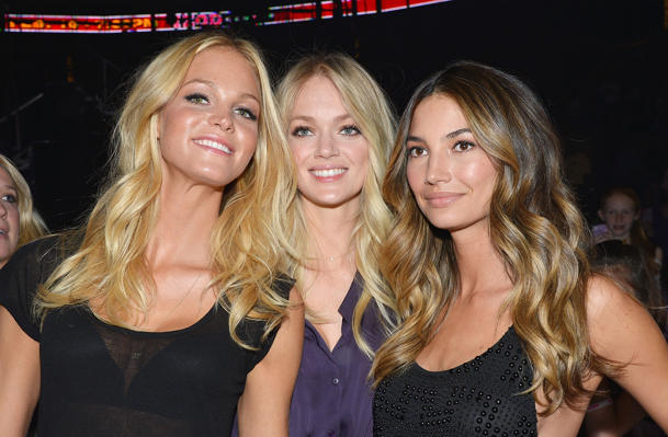 L-R: Erin Heatherton, Lindsay Ellingson, Lily Aldridge at Bieber's Izod Center Show (Photo: Mike Coppola)