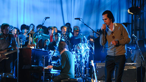 Nick Cave performs with a children's choir in L.A. on 2/22/2013 [photo: Noel Vasquez/Getty]