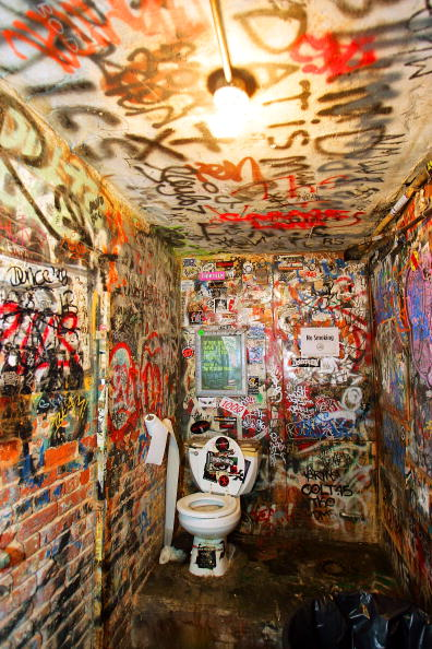 Rocks scariest bathroom immortalized in cbgb the movie for Punk rock bathroom decor
