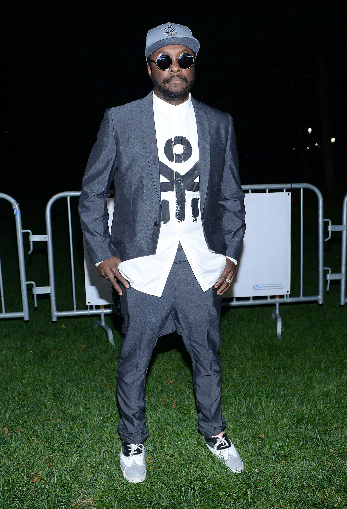 Will.i.am poses in his EKOCYCLE suit at the Global Music Festival. (Getty)