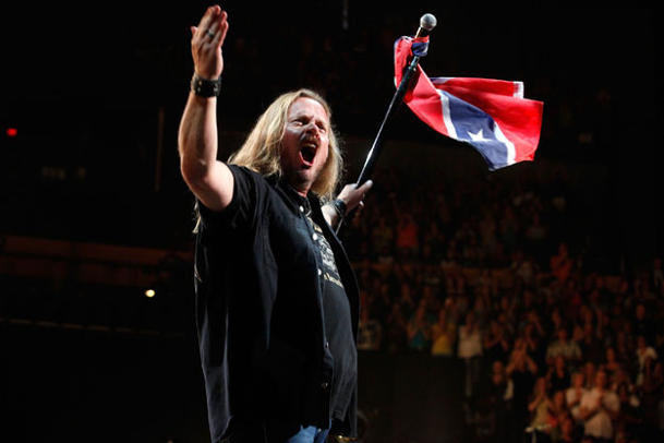 Lynyrd Skynyrd with their once- (and future?) favorite flag (Getty Images)