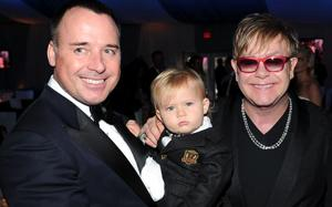 Elton John, David Furnish, and Zacahary at a 2012 Oscars party