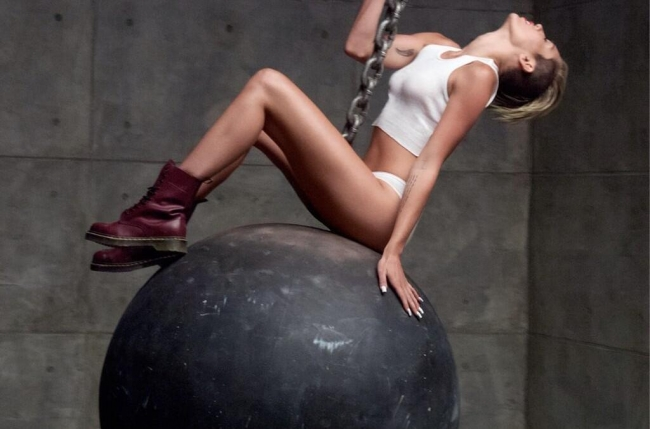 Miley Cyrus Swings Naked From a Wrecking Ball in New Video