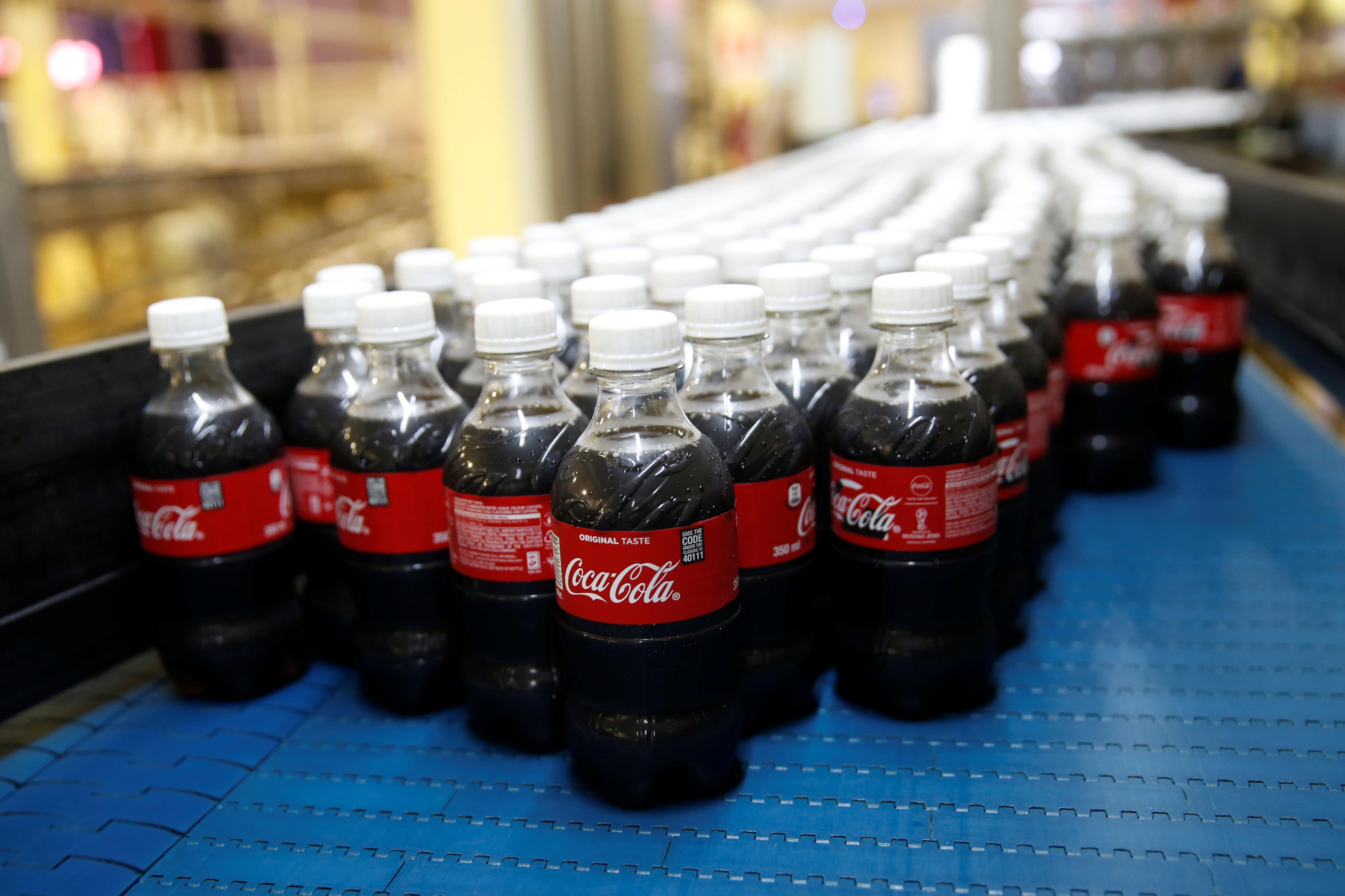 信游娱乐客户端/可口可乐公司首次披露了它每年