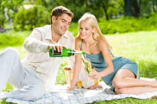Couple having picnic with champagne