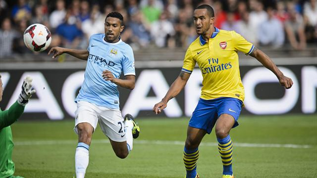 Premier League - Walcott on song as Arsenal put three past Man City in Finland