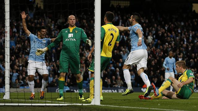 Premier League - Hartless City thump Norwich