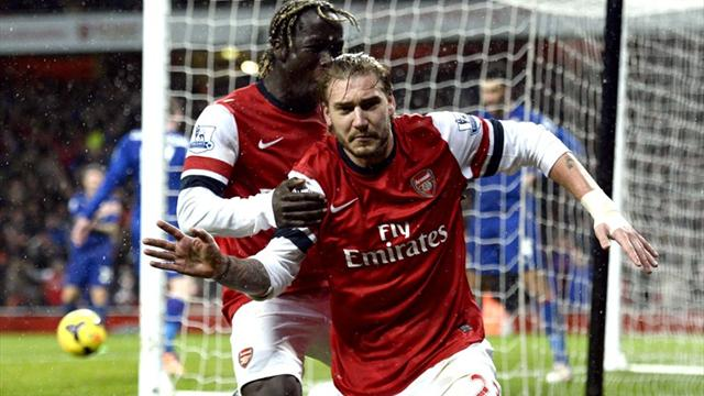 Premier League - Arsenal return to the top after late goals break Cardiff hearts