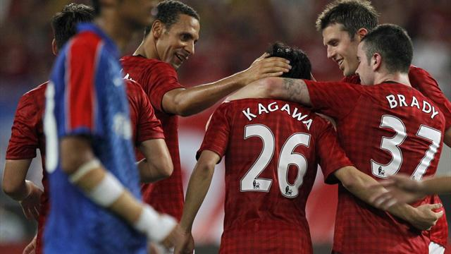 Kagawa scores as United beat Shanghai