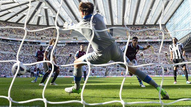 Clark header helps Villa hold Newcastle
