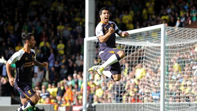 Suarez hat-trick hands Liverpool first Premier League win