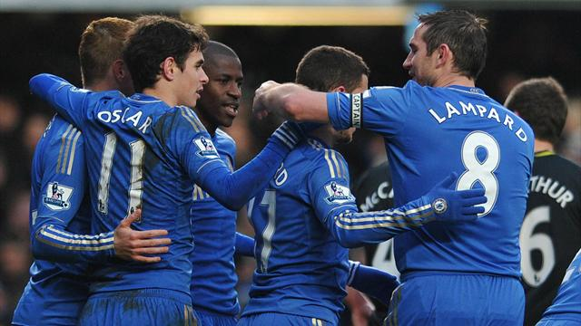 Premier League - Late strikes ease Chelsea past Wigan