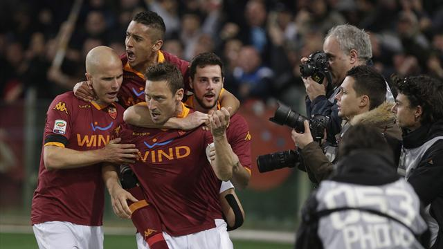 Serie A - Tale of two penalties sees spoils shared in Rome derby