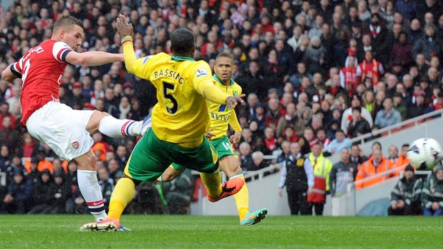 Premier League - Arsenal go third as late goal rush sinks Norwich