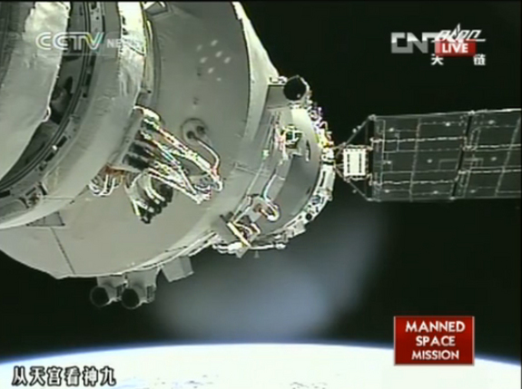 chinese astronauts manually dock spacecraft at orbiting module in national first