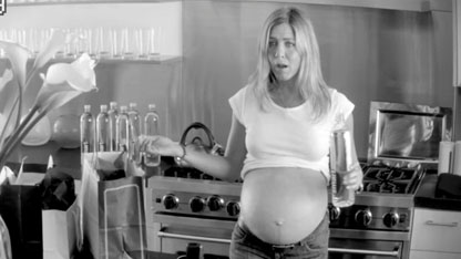 Aniston's Baby Bump Revealed in Stolen Footage