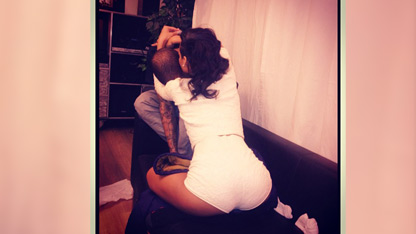 Rihanna Straddles Chris Brown in New Photo