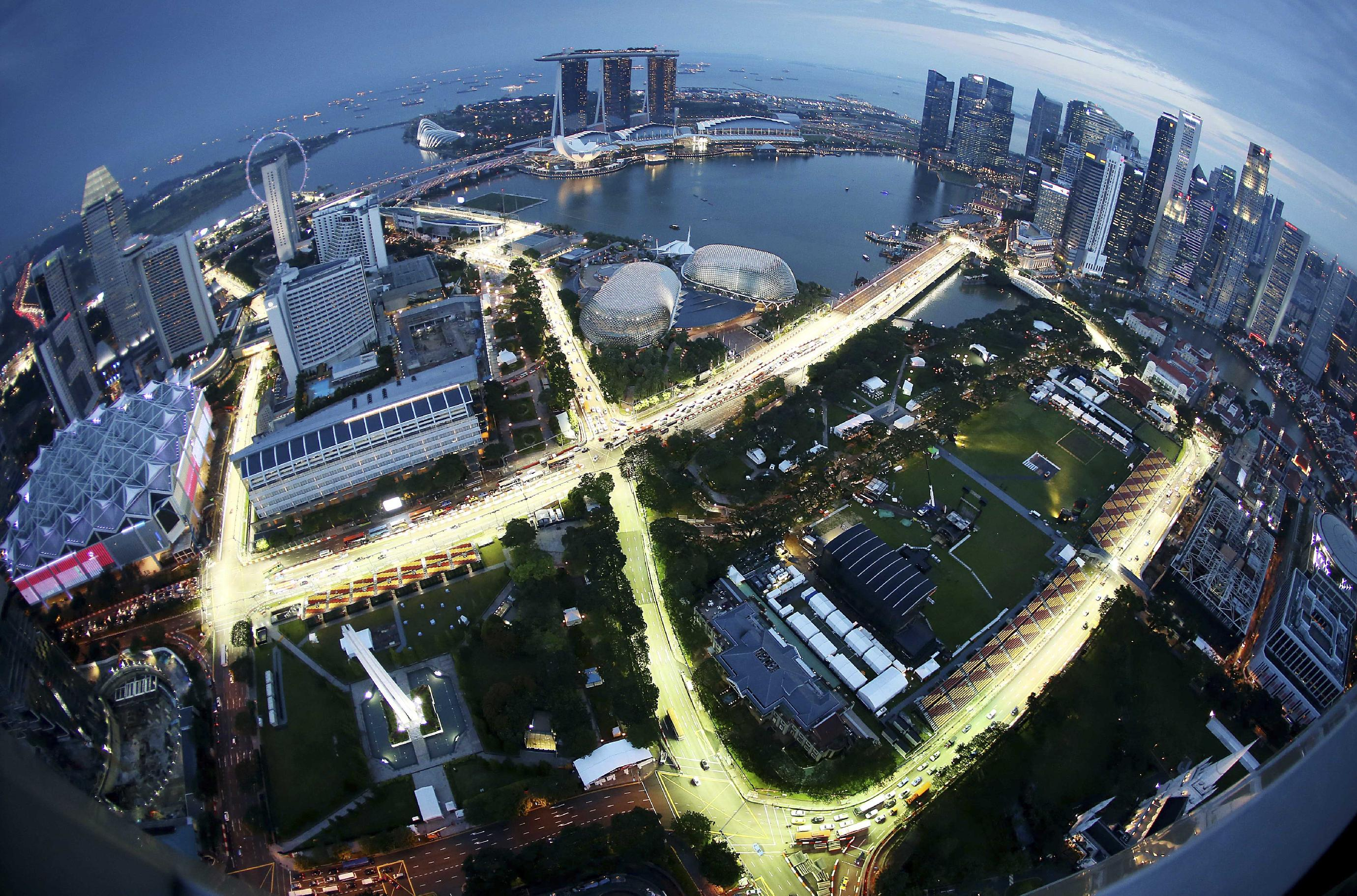 A birdeye view of the Singapore F1 Grand Prix's Marina Bay City Circuit, shot with a fish-eye lens, is seen at dusk from Swissotel The Stamford in Singapore, Tuesday, Sept. 17, 2013. The race is slated for September 21-23