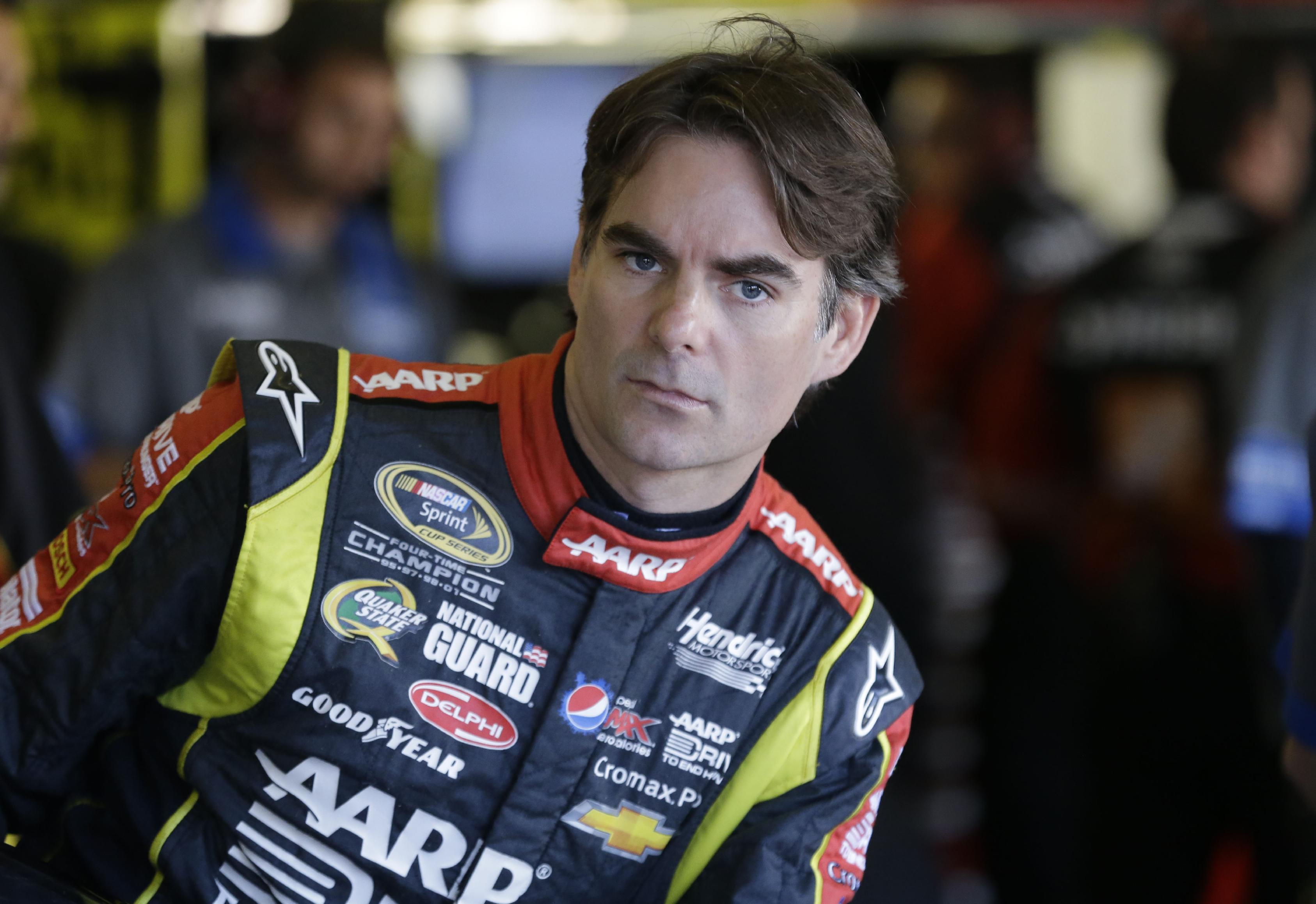 Driver Jeff Gordon (24) leans and looks out from the garage before practice for Sunday's NASCAR Sprint Cup series auto race at the Texas Motor Speedway in Fort Worth Friday, Nov. 1, 2013