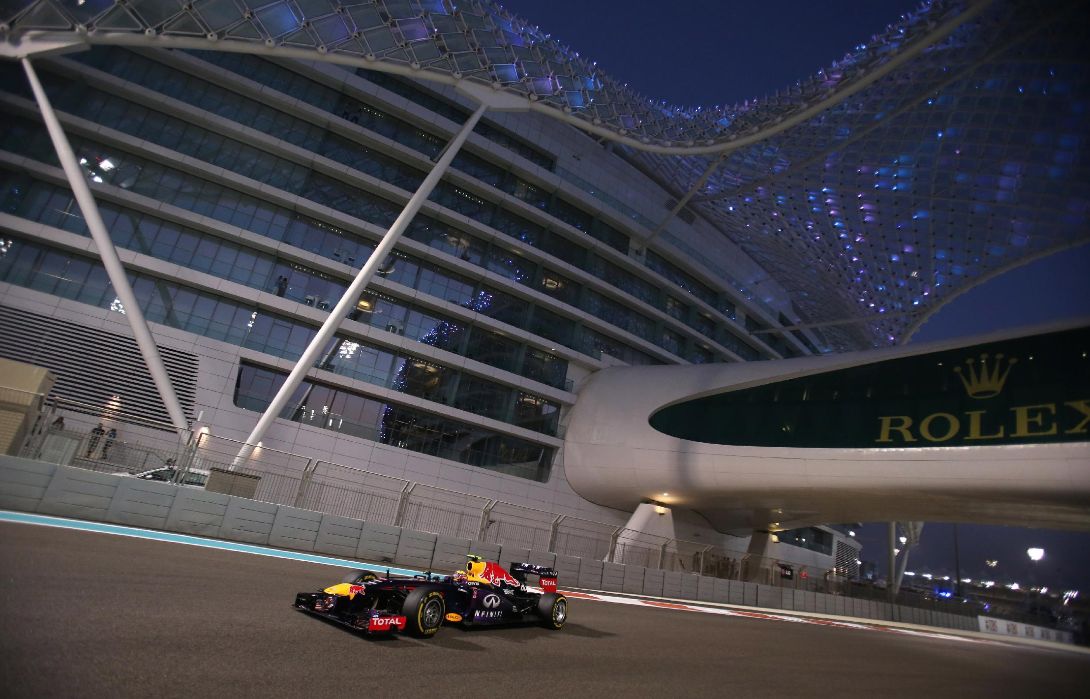 Red Bull driver Mark Webber of Australia steers his car during the qualifying session at the Yas Marina racetrack in Abu Dhabi, United Arab Emirates, Saturday, Nov. 2, 2013