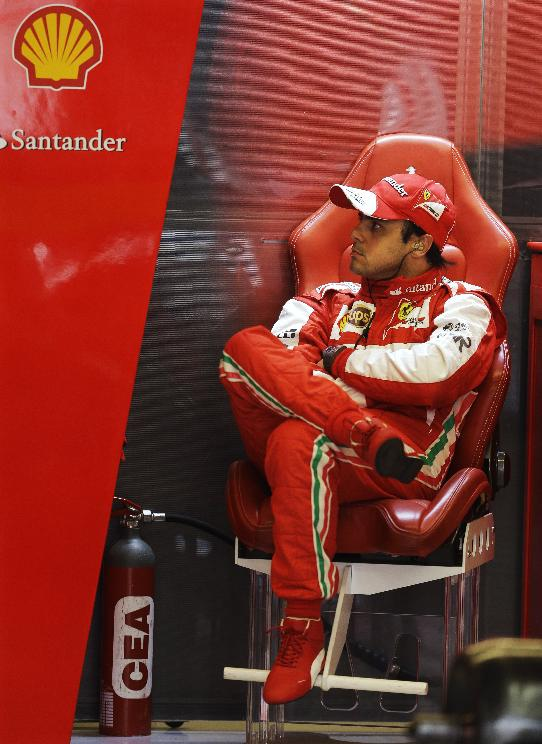 Ferrari driver Felipe Massa of Brazil sits in the team's garage before the third practice session for the Formula One U.S. Grand Prix auto race at the Circuit of the Americas, Saturday, Nov. 16, 2013, in Austin, Texas