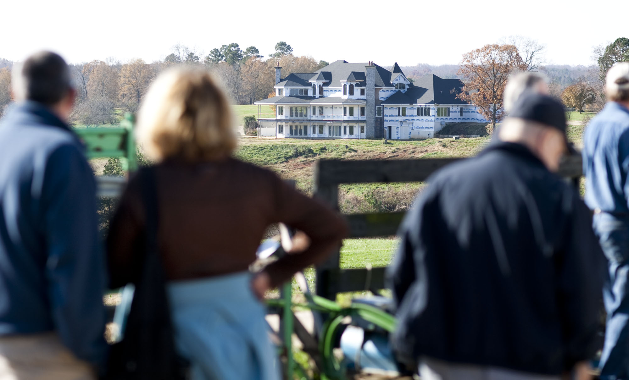 In this Nov. 20, 2009 file photo, auction attendees look at suspended NASCAR Sprint Cup driver Jeremy Mayfield's home, under renovation, during a public auction at Mayfield's Catawba, N.C. property. The million-dollar North Carolina home once owned by Mayfield before he was kicked off the land is scheduled to be burned to the ground as part of a fire training exercise. The Catawba County Fire Marshal's Office says the 12,000-square-foot unfinished house will be burned down on Saturday, Dec. 14, 2013