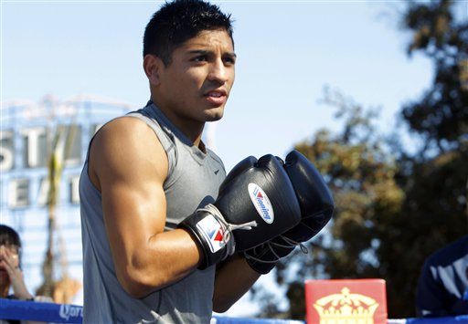 Abner Mares spars during an outdoor public workout in L.A. (AP)