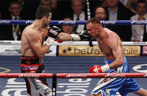 Carl Froch of Britain, left, fights against Mikkel Kessler of Denmark during their super-middleweight world title unification boxing match at O2 Arena in London, Sunday, May 26, 2013. Froch won a unanimous decision over Kessler, avenging his first career defeat and adding the WBA championship to his IBF belt