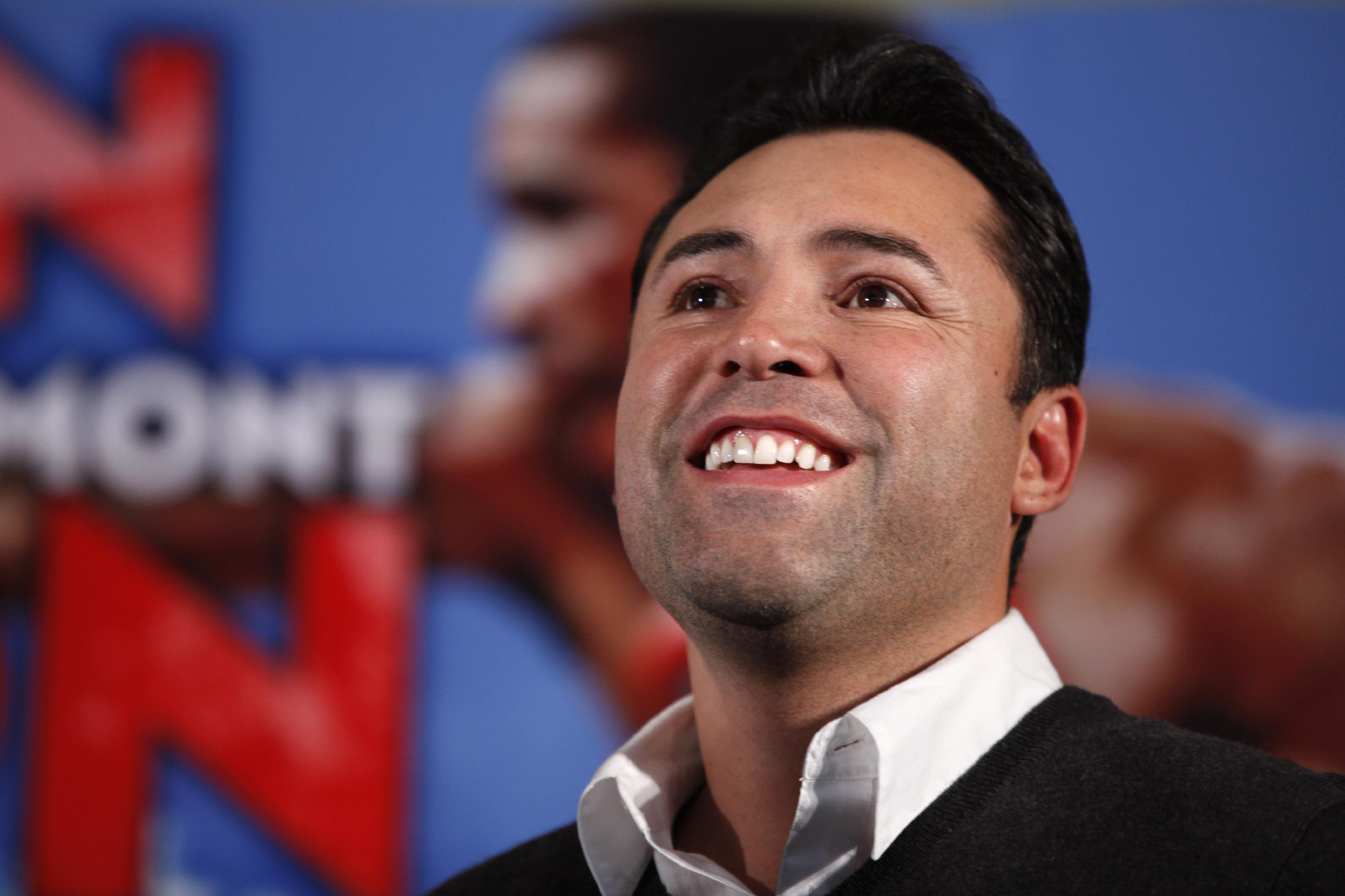 In this Dec. 9, 2011, file photo, boxing promoter Oscar De La Hoya watches during the the weigh-in for a fight between Amir Kahn and Lamont Peterson in Washington. The former boxer issued a statement Tuesday, Sept. 10, 2013, saying he voluntarily admitted himself to an unnamed facility as he continues to fight his substance abuse
