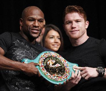 Boxers Floyd Mayweather, left, and Canelo Alvarez pose during a press conference in Las Vegas, Wednesday, Sept. 11, 2013. The pair are scheduled to fight on Saturday for Mayweather's WBA Super World and Alvarez's WBC junior middleweight titles