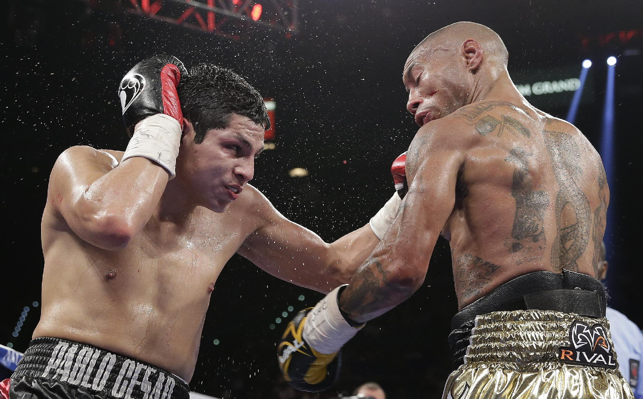 Pablo Cesar Cano, left, lands a punch against Ashley Theophane in the seventh round during a welterweight fight, Saturday, Sept. 14, 2013, in Las Vegas
