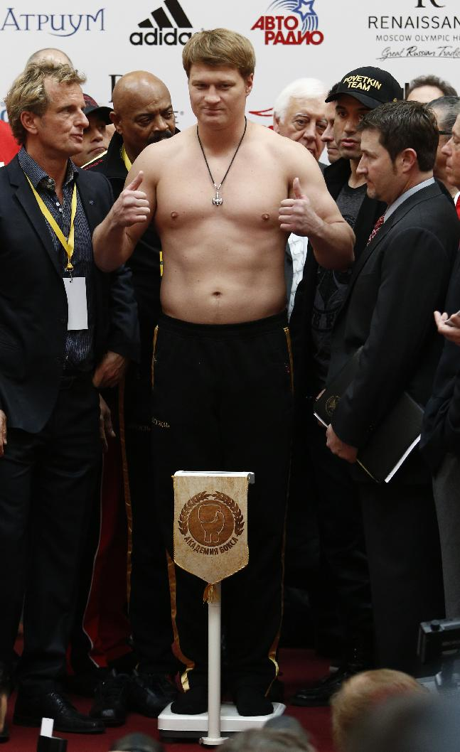 Russian boxer Alexander Povetkin, center, is weighed during the weigh-in session in Moscow, Russia, on Friday, Oct. 4, 2013. Heavyweight champion Wladimir Klitschko of Ukraine will defend his WBA and IBF belts against Russia's Alexander Povetkin at the Olympic Stadium in Moscow on Saturday