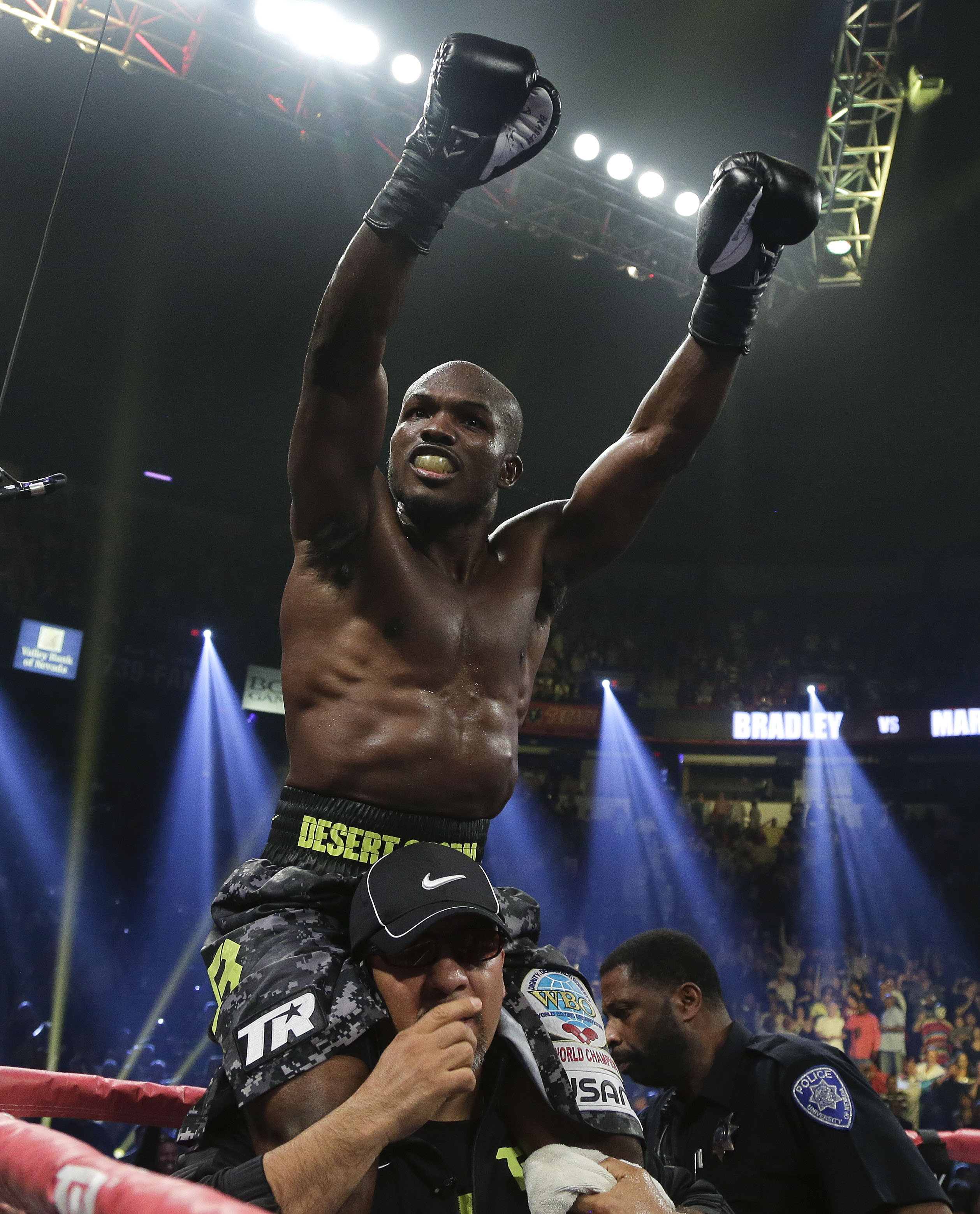 Timothy Bradley celebrates after defeating Juan Manuel Marquez by split decision during a WBO welterweight title fight, Saturday, Oct. 12, 2013, in Las Vegas