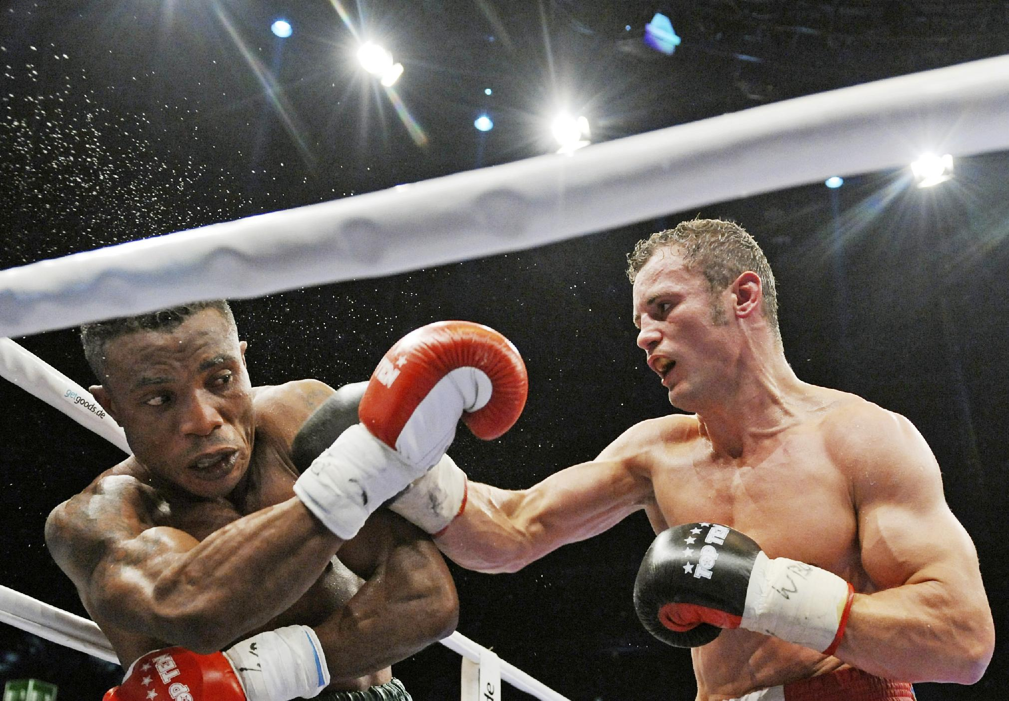 Robert Stieglitz of Germany, right, lands a punch to Isaac Ekpo of Nigeria during their WBO Super Middleweight Championship title bout in Leipzig, central Germany, Saturday, Oct. 19, 2013. Stieglitz retained his title