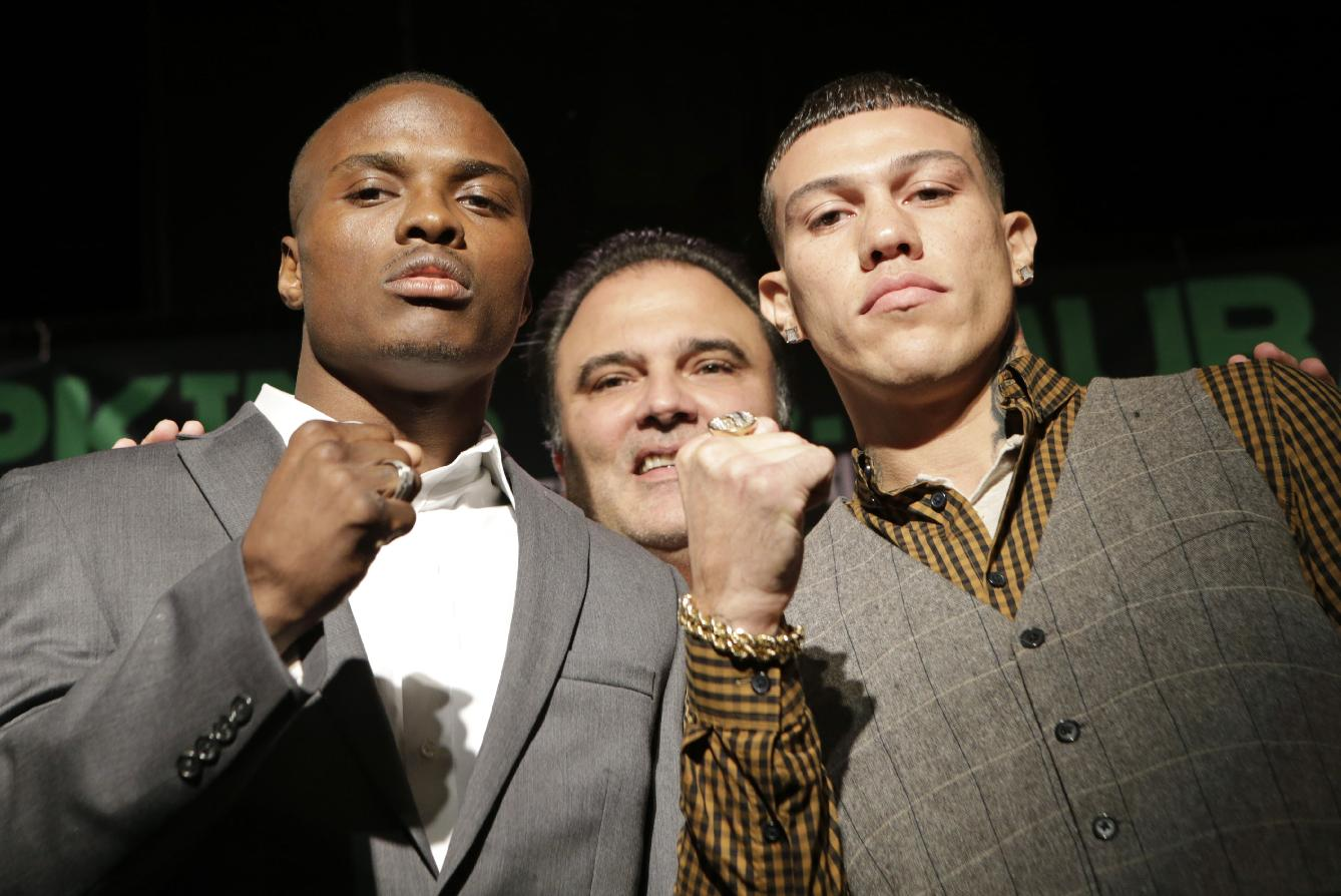 Golden Boy Promotions CEO Richard Schaefer, center, poses with boxers Peter Quillan, left, and Gabriel Rosado during a photo opportunity after a news conference Wednesday, Oct. 23, 2013, in New York, in advance of their WBO middleweight title fight on Saturday in Atlantic City, N.J