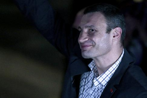 WBC heavyweight champion Vitali Klitschko, of Ukraine, smiles attending a boxing evening in Moscow, Russia, on Friday, May 17, 2013