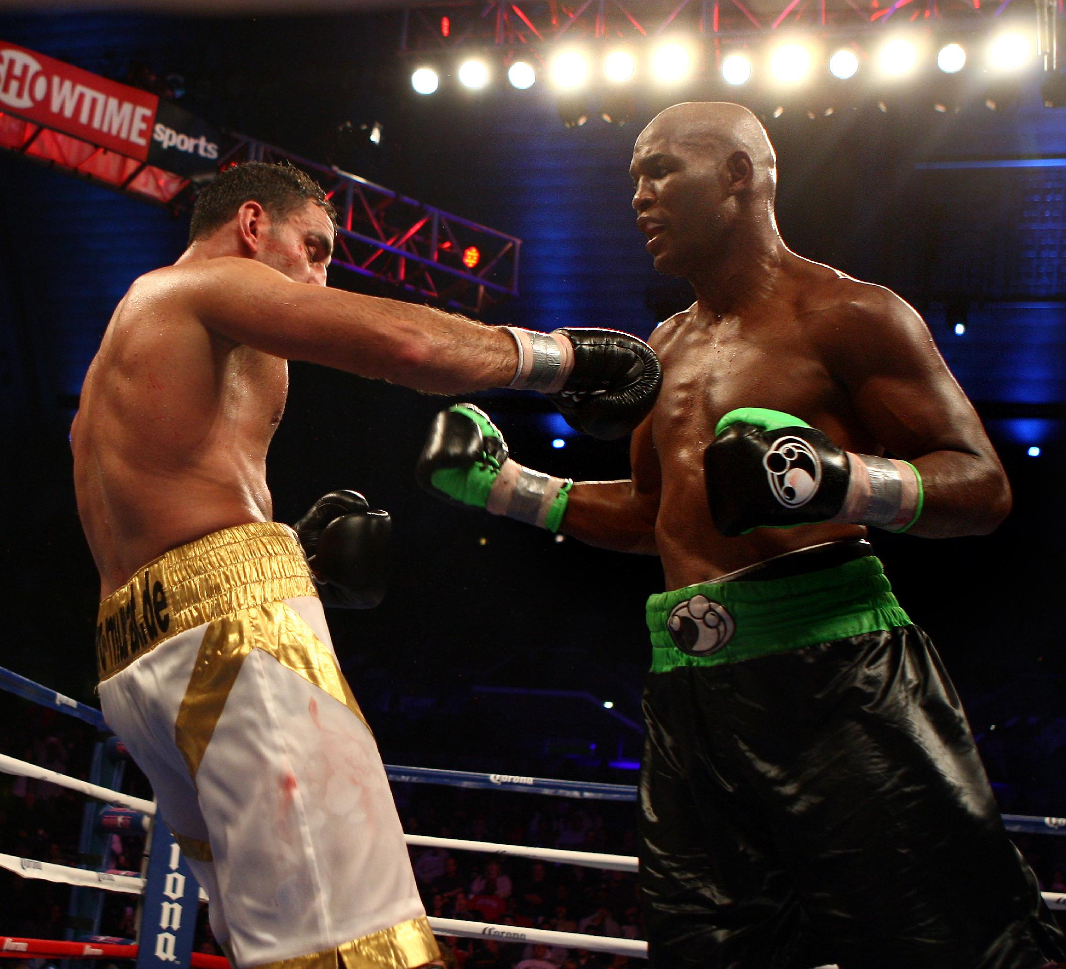 Bernard Hopkins, right, of Philadelphia, PA goes after Karo Murat of Germany during the 12th round of IBF Light Heavyweight Title in Atlantic City, N.J. on Saturday, Oct. 26, 2013. Hopkins won by unanimous decision after 12 rounds