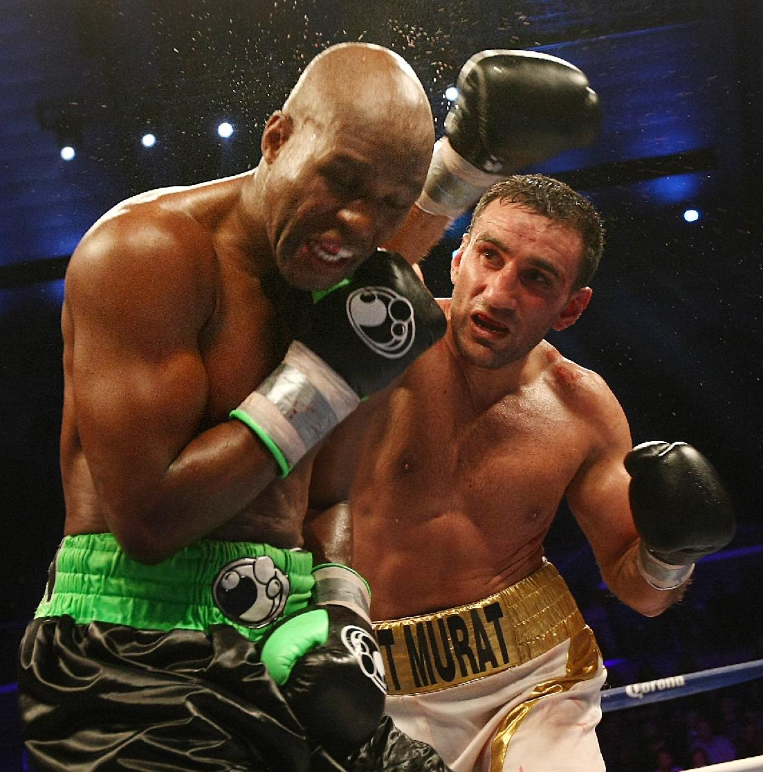 Karo Murat, right, of Germany lands a punch on Bernard Hopkins, of Philadelphia, PA lands a punch on  during the ninth round of IBF Light Heavyweight Title in Atlantic City, N.J. on Saturday, Oct. 26, 2013. Hopkins won by unanimous decision after 12 rounds