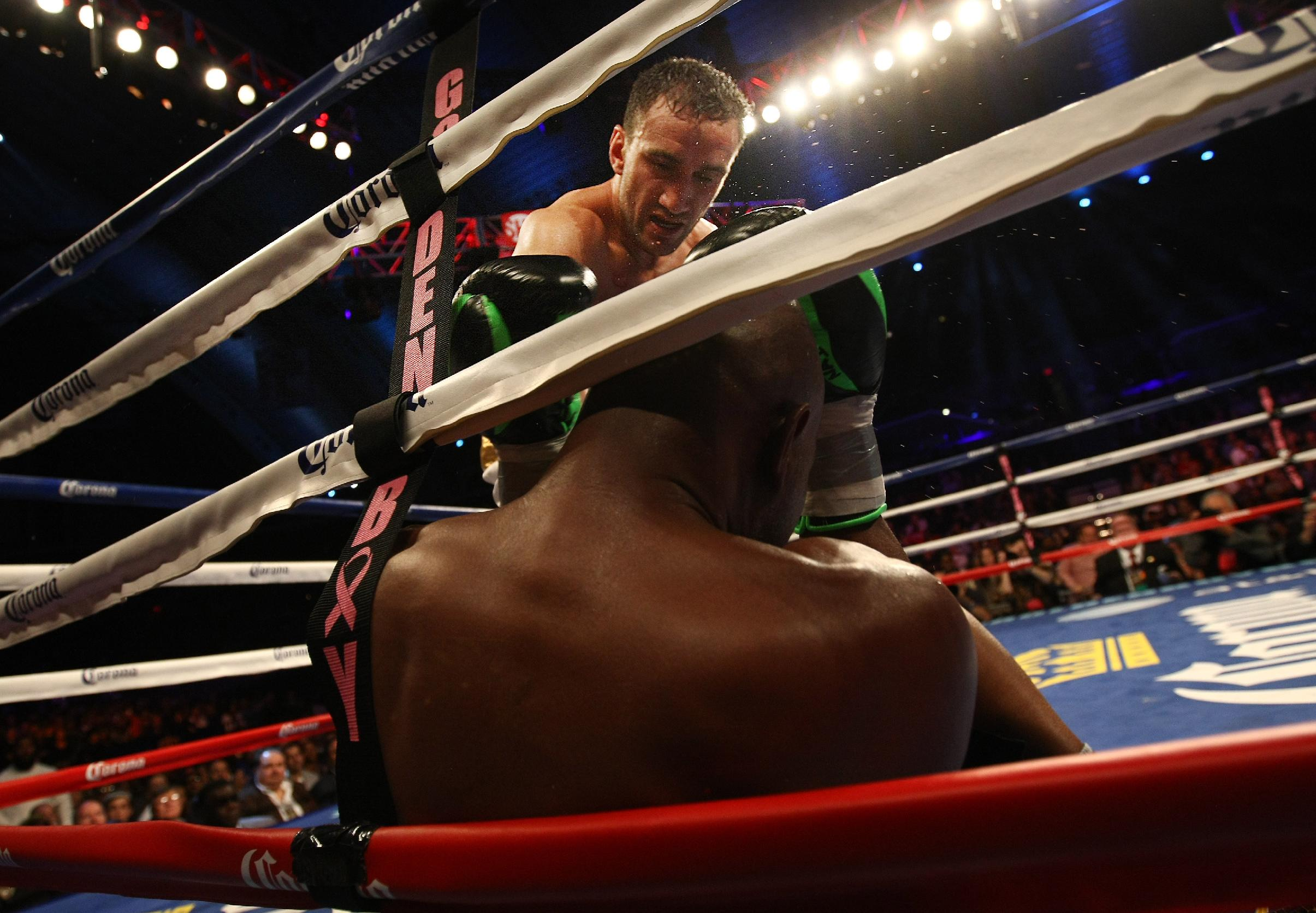 Karo Murat, standing, of Germany throws a punch on Bernard Hopkins, of Philadelphia, PA who was sitting on the ground against the ropes during the sixth round of IBF Light Heavyweight Title in Atlantic City, N.J. on Saturday, Oct. 26, 2013. Hopkins won by unanimous decision after 12 rounds