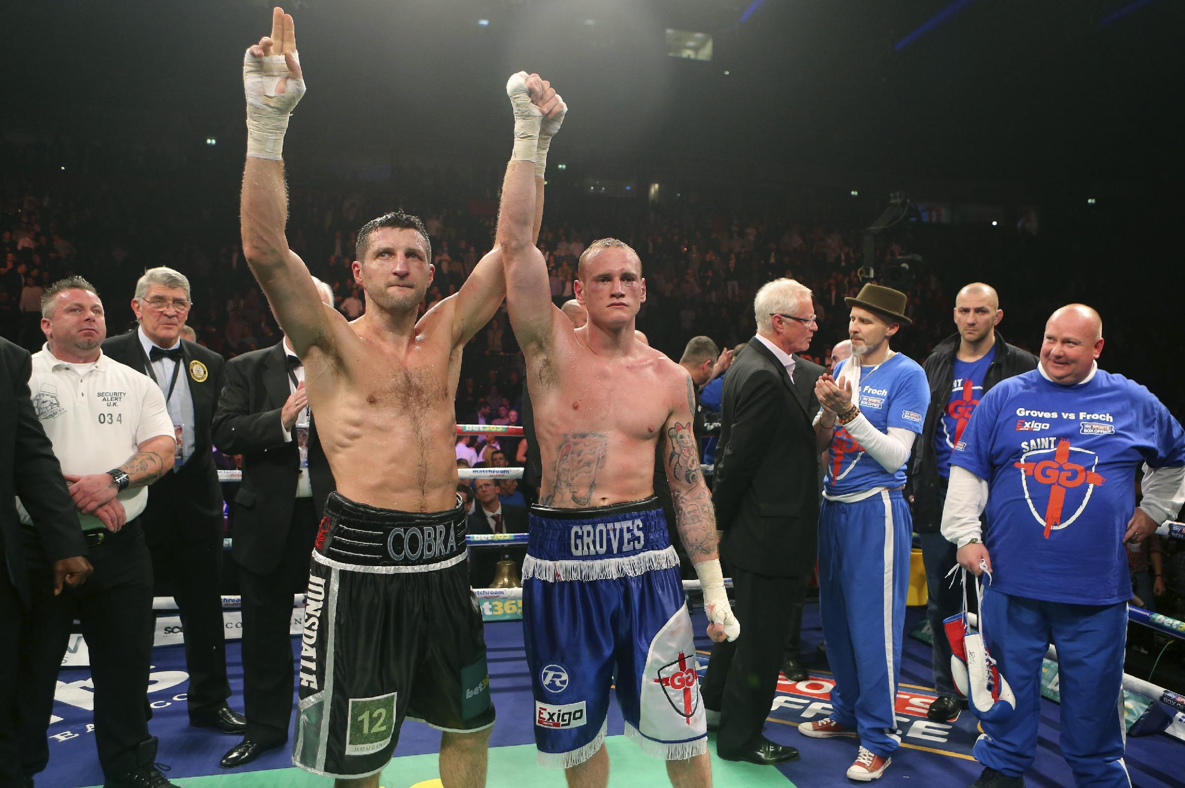 Britain's Carl Froch, left, and compatriot George Groves raise their arms together following their WBA and IBF super-middleweight title fight at the Phones 4u Arena, in Manchester, England, Saturday, Nov. 23, 2013.   Froch recovered from a first-round knockdown to retain his WBA and IBF super-middleweight titles with a ninth-round technical knockout of Groves in an engrossing fight on Saturday