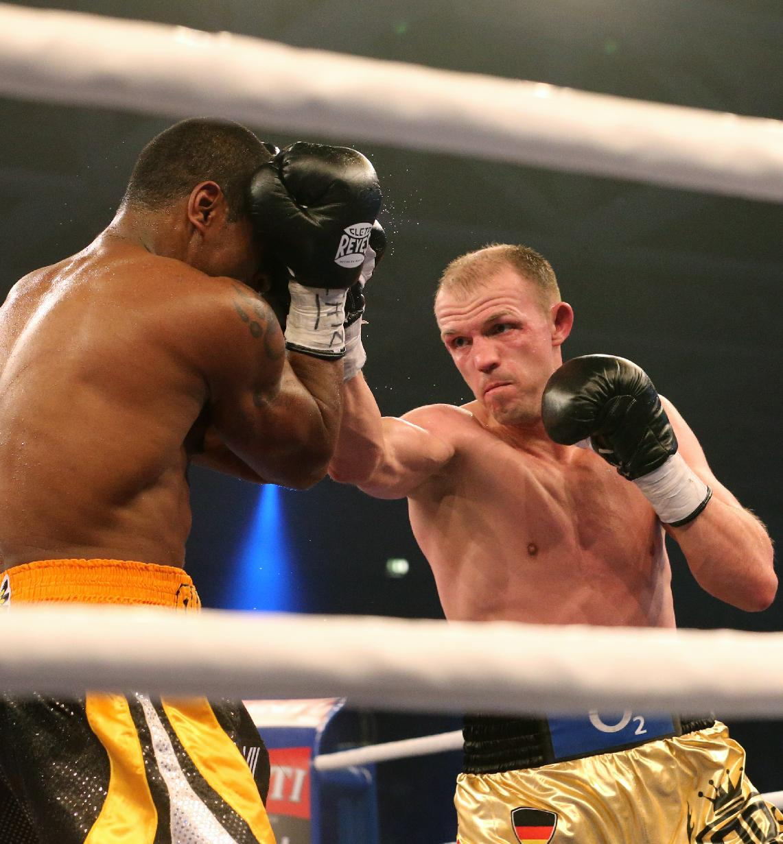 In this picture taken Saturday evening Dec. 14, 2013, German  boxer Juergen Braehmer, right,  punches  US Marcus Oliveira   during their title bout in Neubrandenburg, eastern Germany. Germany's Juergen Braehmer defeated Marcus Oliveira by unanimous decision to take the vacant WBA world light heavyweight title on Saturday night. The judges scored it  in favor of the 35-year-old Braehmer, a former WBO champion, who withstood a late barrage from the previously undefeated American in the last round to claim his second world title. The title had been vacant since Kazakhstan's Beibut Shumenov was declared the WBA's