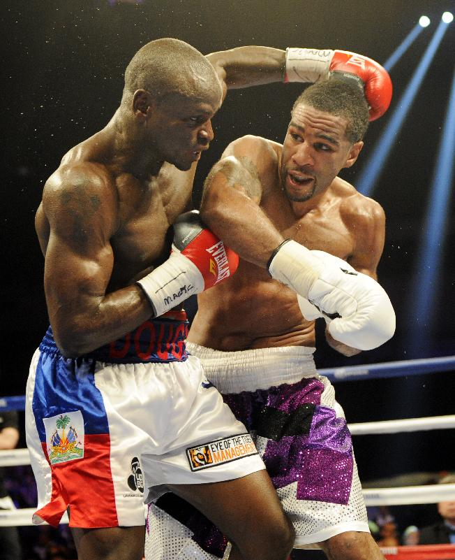 Lamont Peterson, right, battles Dierry Jean, of Canada, left, during the IBF Junior welterweight title boxing match, Saturday, Jan. 25, 2014, in Washington. Peterson won the match