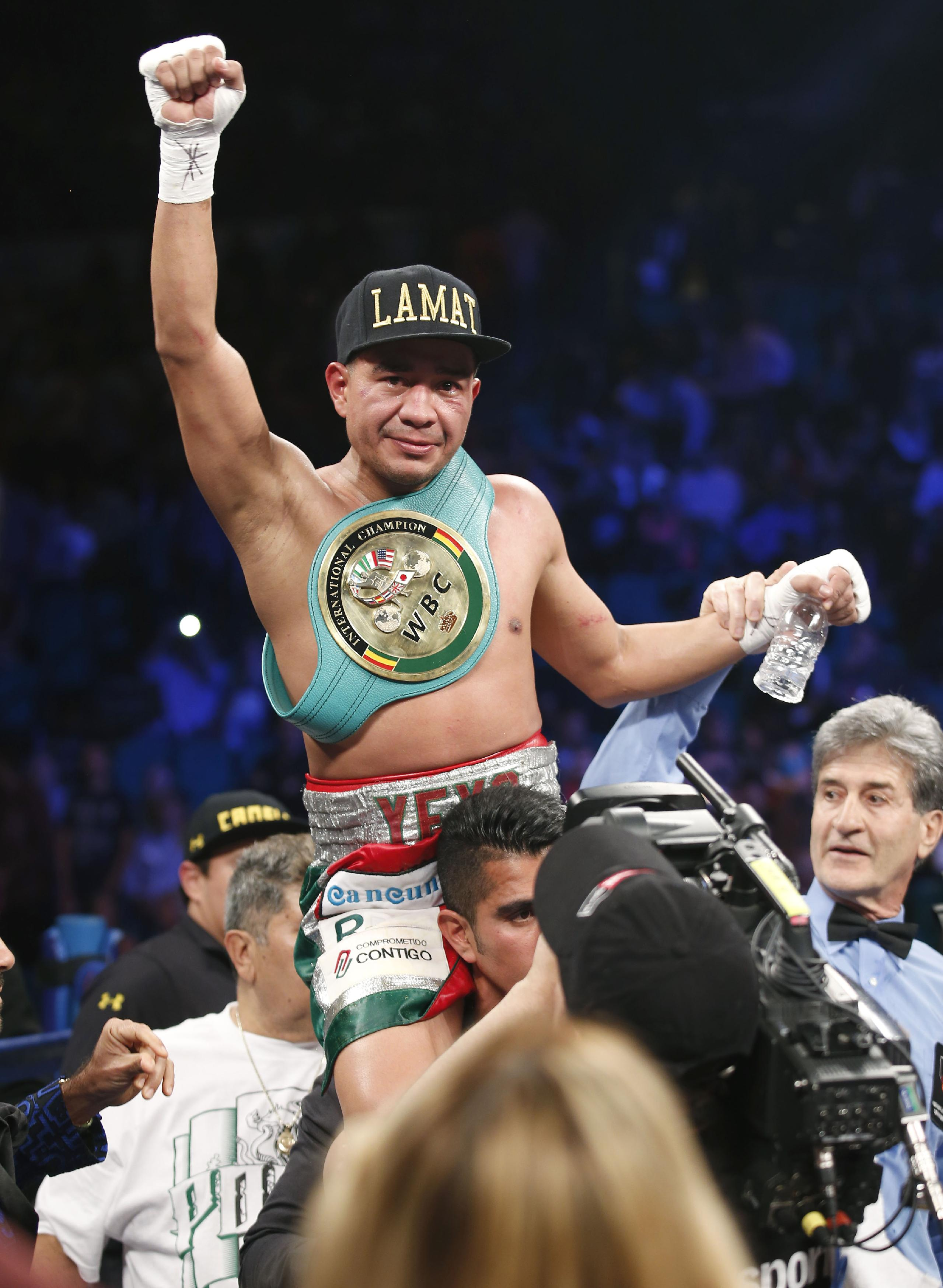 Sergio Thompson of Chetumal Mexico celebrates his unanimous decision victory over Ricardo Alvarez of Guadalajara Mexico just after their WBC lightweight boxing match, Saturday, March 8, 2014, at The MGM Grand Garden Arena in Las Vegas