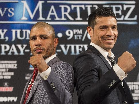 WBC middleweight champion Sergio Martinez, right, of Argentina, and challenger Miguel Cotto, of Puerto Rico, pose for photos during a news conference in Beverly Hills, Calif., Wednesday, Mar. 12, 2014. Cotto and Martinez will face in a World Middleweight Championship bout scheduled June 7, in New York's Madison Square Garden