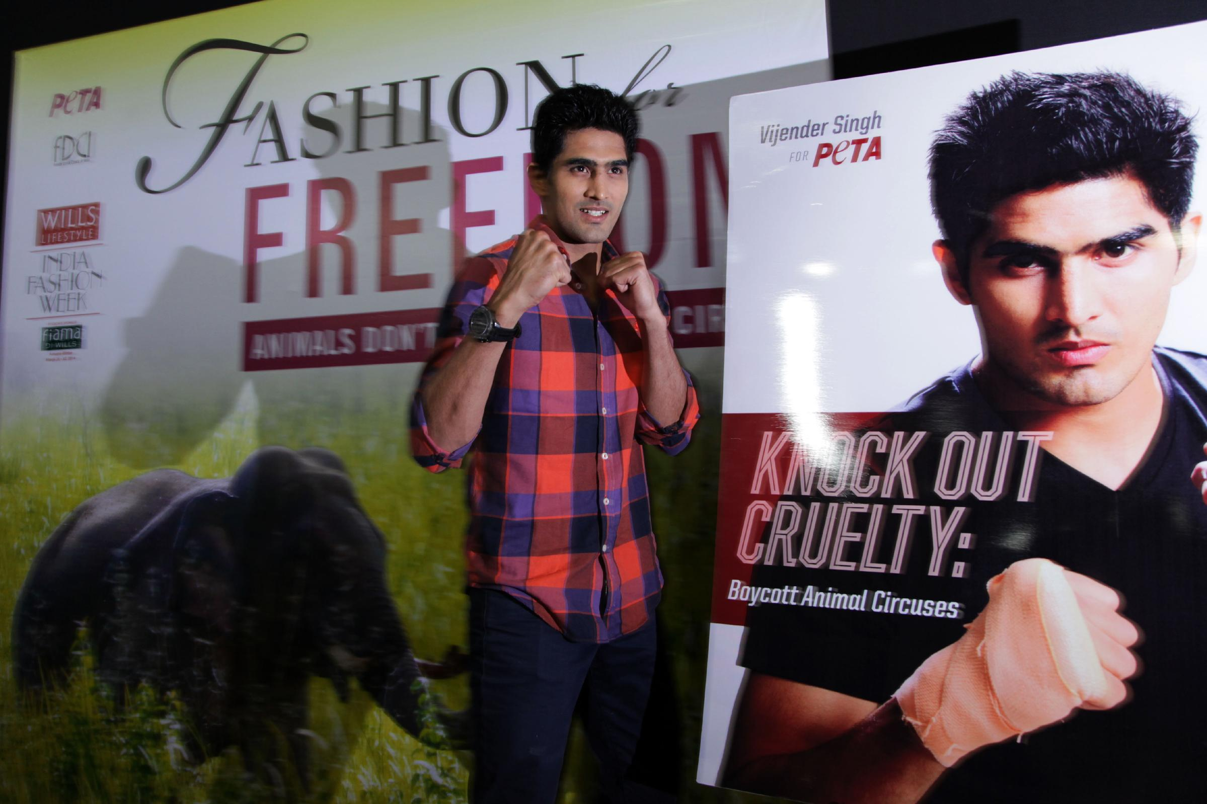 Indian boxer and Olympic medalist Vijender Singh poses during the launch of a campaign by People for the Ethical Treatment of Animals (PETA) and Wills Lifestyle India Fashion week in New Delhi, India, Friday, March 28, 2014. Singh is campaigning with PETA for the boycott of use of animals in circuses