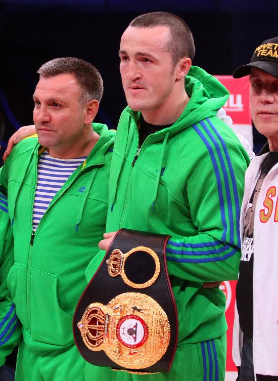 WBA cruiserweight title holder Denis Lebedev, of Russia, center, holds his belt as he and his team members stand in a ring in Moscow, Russia, Friday, April 25, 2014. In May 2013 Guillermo Jones, of Panama, stopped Lebedev on a technical knockout in 11th round. Then, the WBA handed the title back to Lebedev when Jones failed a drug test. Jones was made WBA champion-in-recess on the condition he must fight Lebedev again. But Jones failed his doping test again and rematch was cancelled
