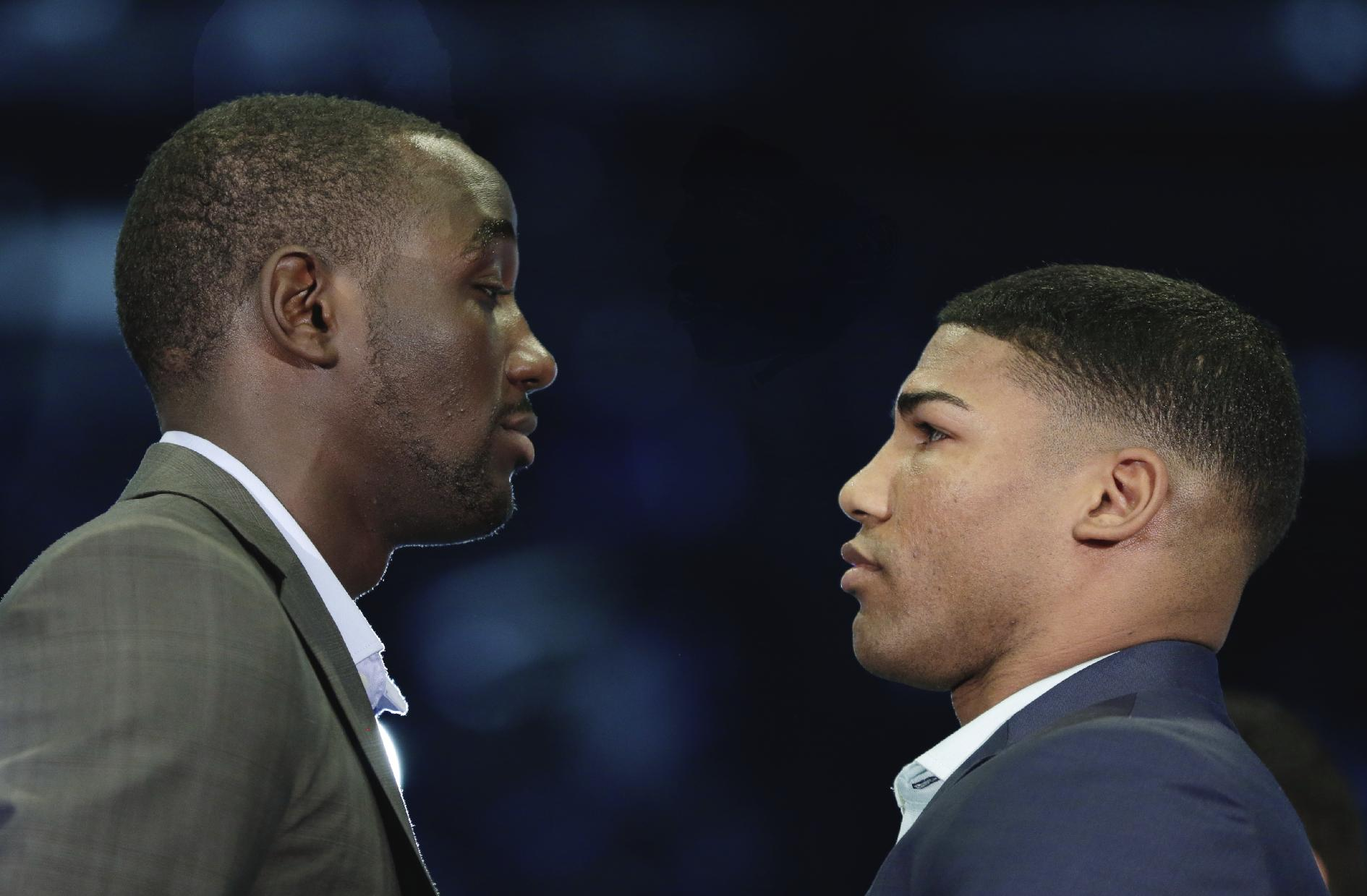Terence Crawford, left, and Yuriorkis Gamboa pose for a photo at a news conference in Omaha, Neb., Thursday, May 8, 2014,  to announce their world lightweight championship fight in June. Crawford will defend his WBO title in his hometown, in the first world championship fight in Omaha since Joe Frazier stopped Ron Stander in 1972